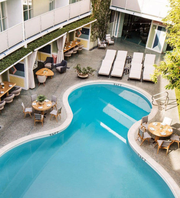 Avalon Hotel Beverly Hills, Los Angeles - bird's eye view of a hotel pool with shady cabanas, tables, chairs, and lounge chairs