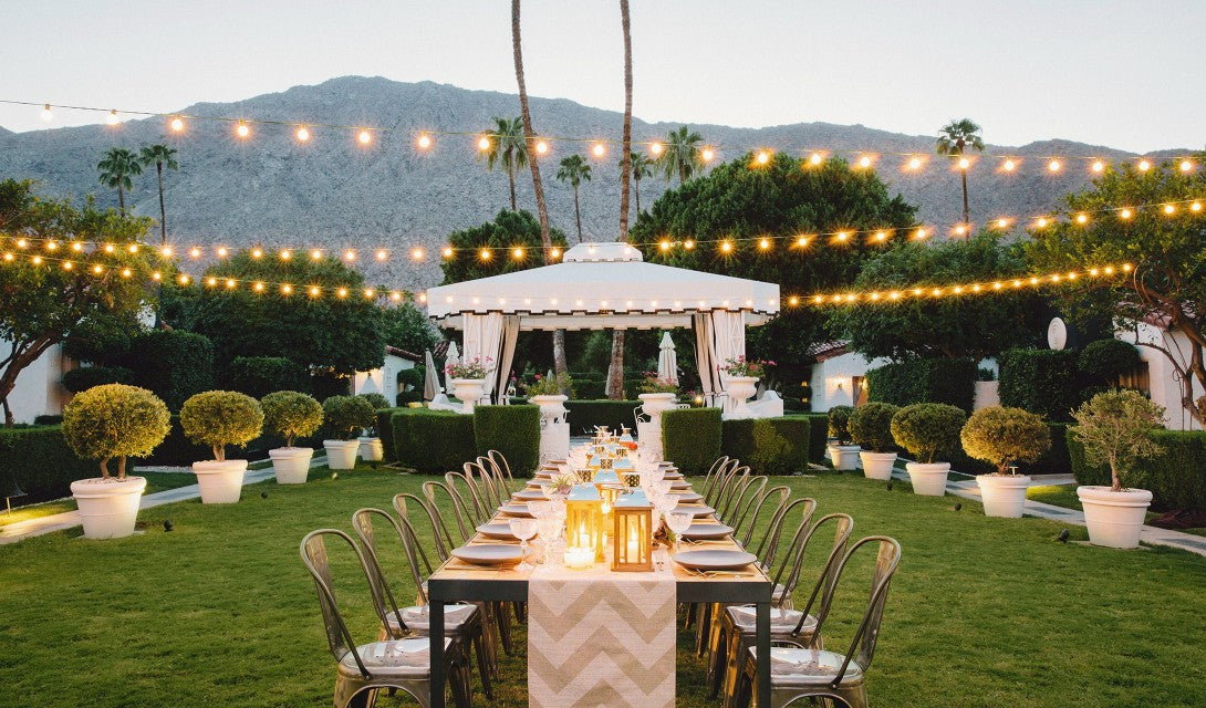 Avalon Hotel & Bungalows, Palm Springs - outdoor garden event space with set tables, chairs, and large designer tent
