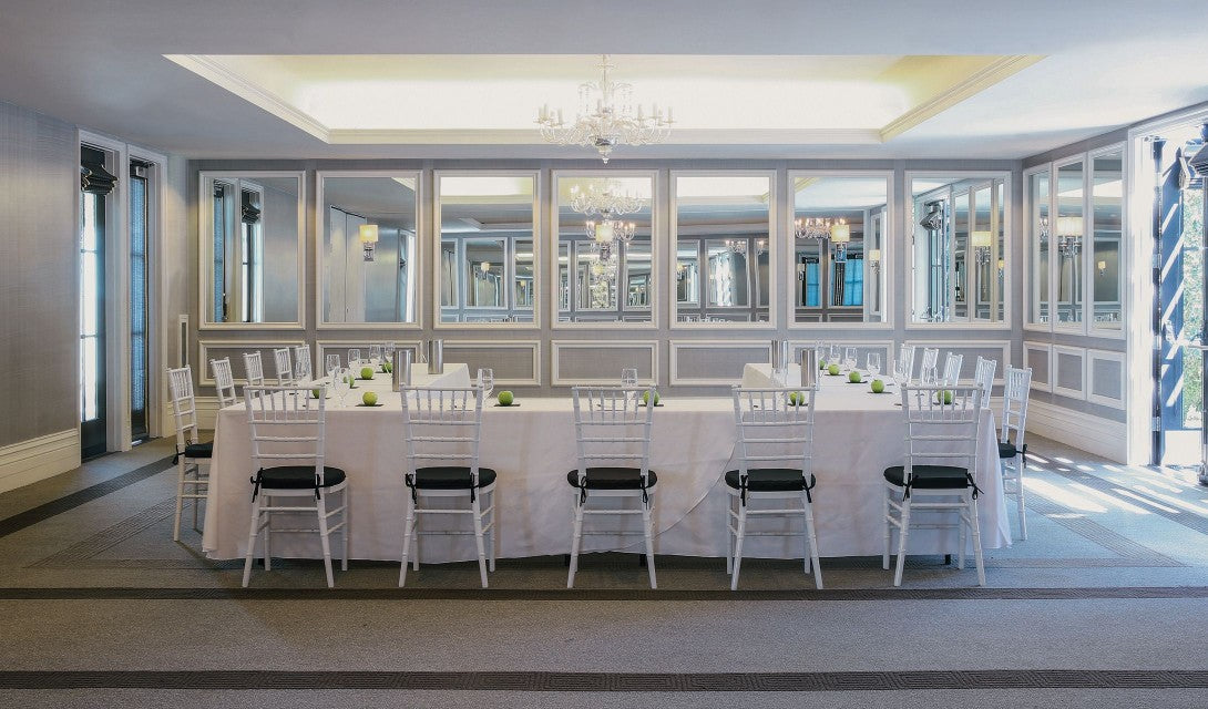 Avalon Hotel & Bungalows, Palm Springs - hotel meeting room and event space with mirrored walls, set table, and chairs