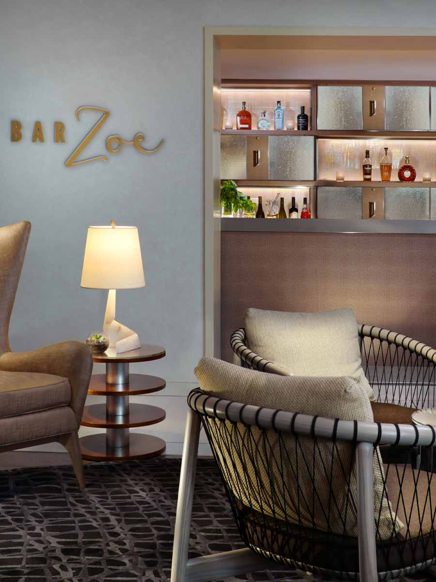 Hotel Zoe Fisherman's Wharf, San Francisco - Bar Zoe with rectangular wall shelving for alcohol, bar, and armchairs