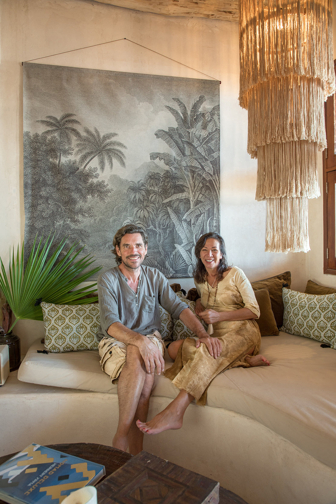 Casa Cat Ba, Isla Holbox - hotel owners Colette and Pierre-Marie seated on a couch