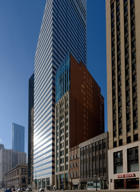 Hotel Julian, Chicago - exterior of modern high rise buildings and classic stone hotel building