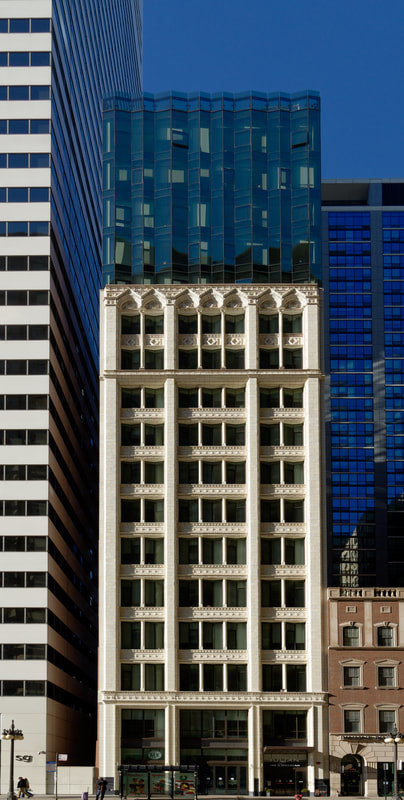 Hotel Julian, Chicago - stone building exterior alongside modern high rise buildings