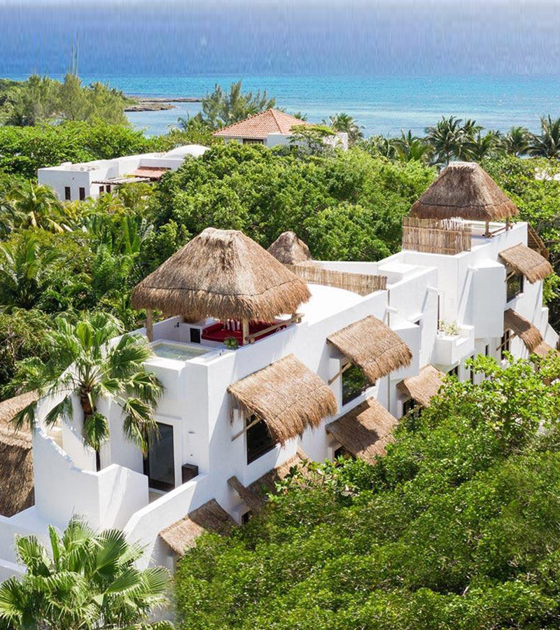 Hotel Esencia, Xpu-Ha - bird's eye view of white hotel villa with thatch roofs and awnings, view of jungle scenery and ocean