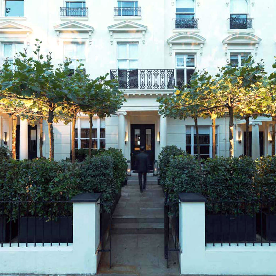 La Suite West, London, UK - hotel exterior, classic white Kensington style exterior with a small patio garden in front