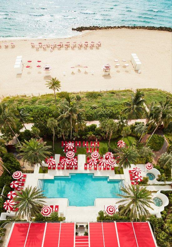 Faena Hotel, Miami Beach - bird's eye view of hotel pool and beach with lounge chairs and sun umbrellas