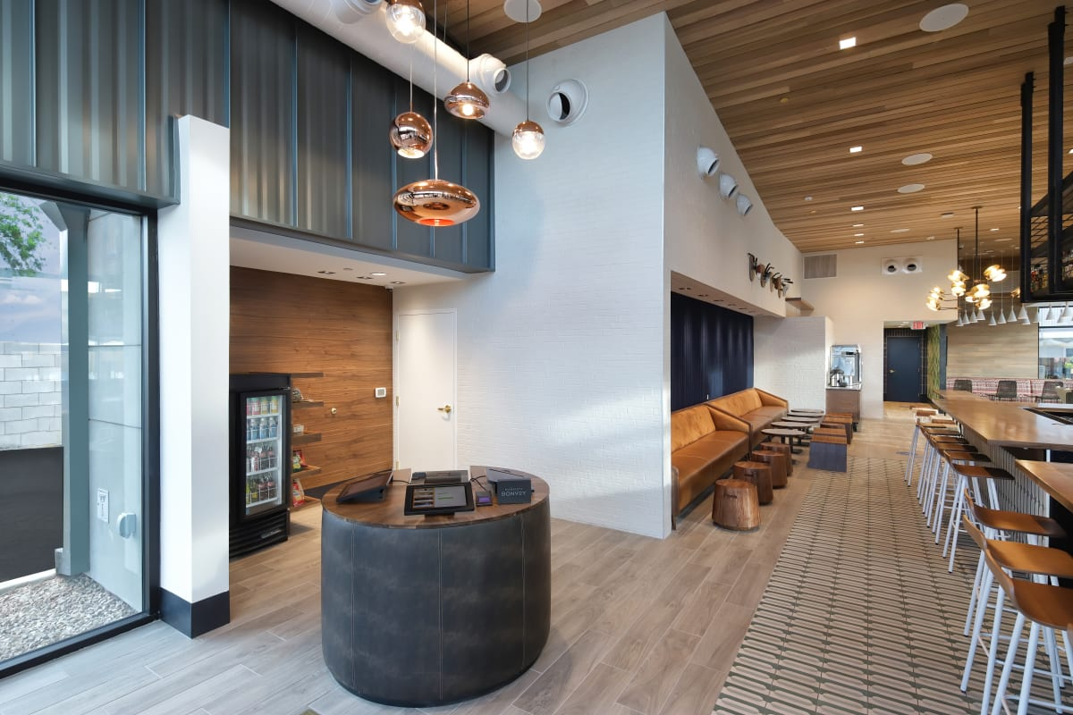 The Tuxon Hotel, Tucson - hotel lobby with leather couches, bar stools, and bar