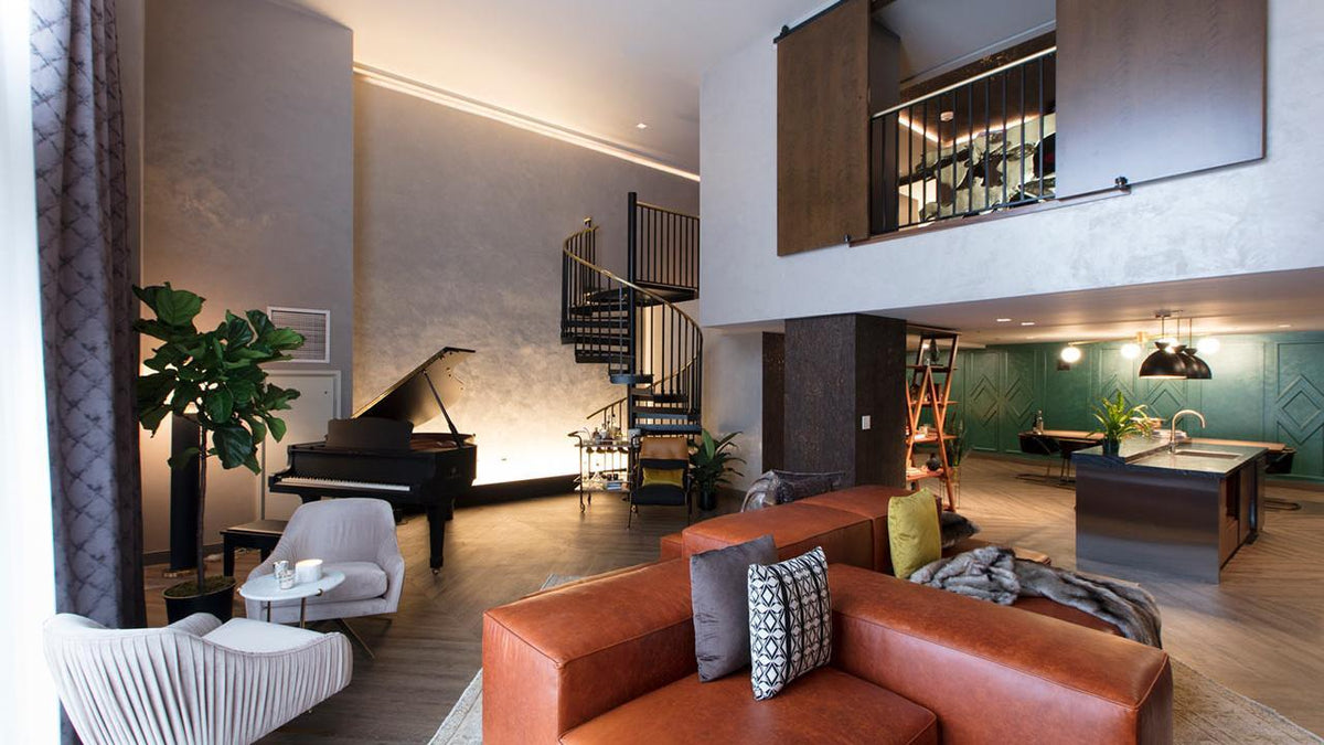 Hutton Hotel, Nashville - hotel penthouse with couch, armchair, kitchen, grand piano, and spiral staircase to a loft