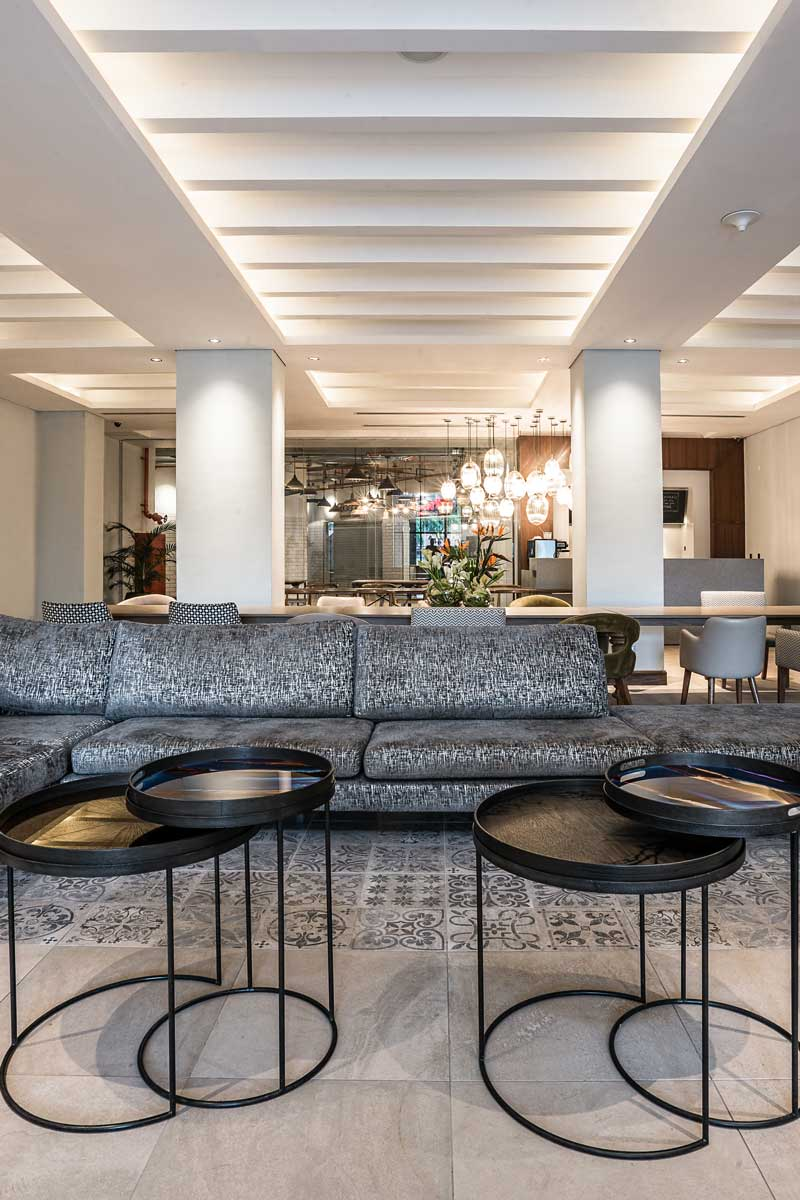 Trademark, Nairobi - hotel lounge with patterned couches and modern round coffee tables
