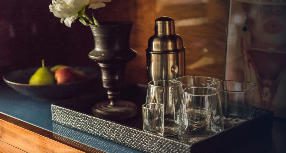 Hotel Hugo, NYC - close up of a small dry bar featuring clean drink glasses, a cocktail shaker, and a cocktail book
