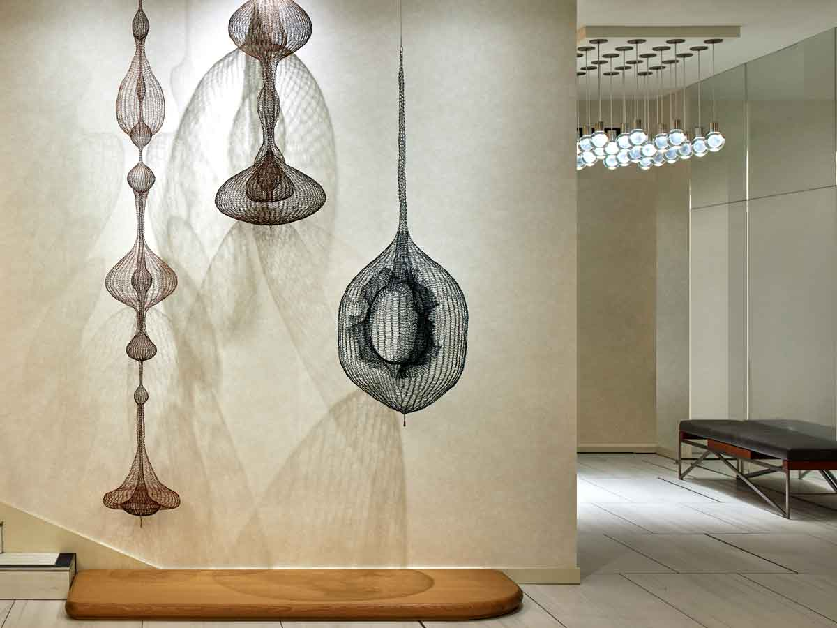 Hotel Zoe Fisherman's Wharf, San Francisco - lobby art of hanging woven mobiles in neutral colors