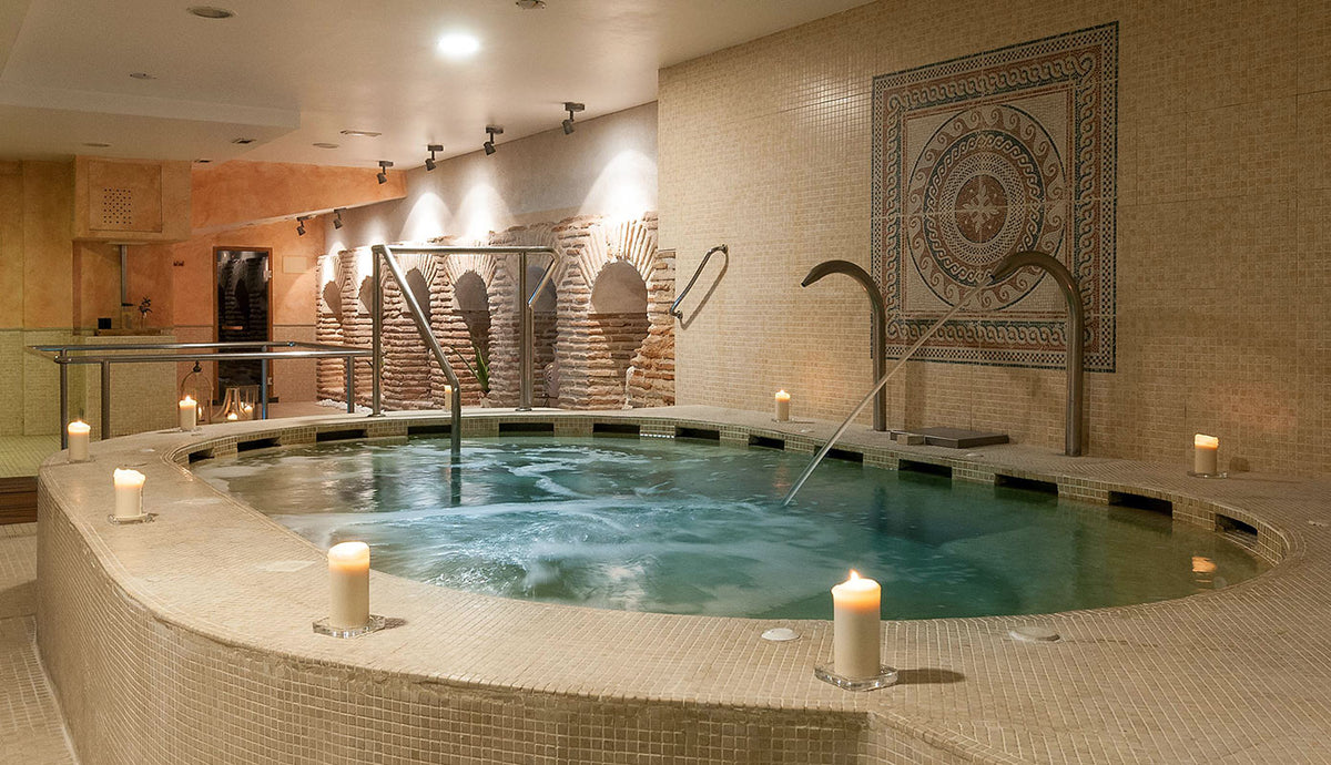 Hotel Eugenia de Montijo, Toledo - hotel spa with candles surrounding an indoor tiled jacuzzi