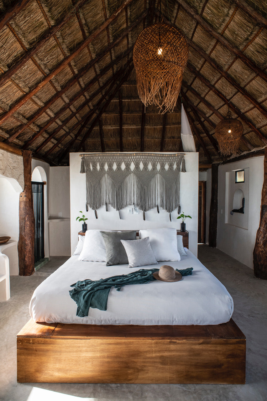 Amansala, Tulum - eco chic hotel room and bed with thatch roof