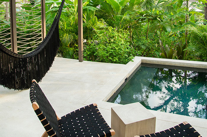 Nantipa, Santa Teresa, Costa Rica - private hotel room pool with black hammock, deck chairs, and jungle view