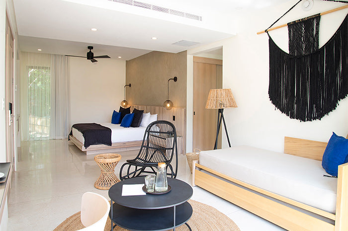 Nantipa, Santa Teresa, Costa Rica - minimalist hotel room with wooden platform bed, and neutral decor