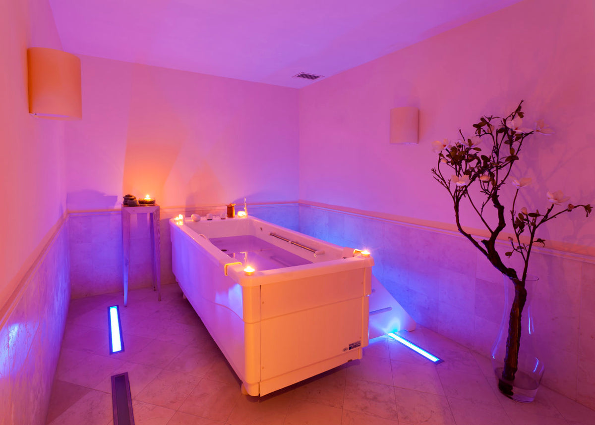 Terme Manzi Hotel & Spa, Ischia - spa tub with soft pink lighting and lit candles around the tub