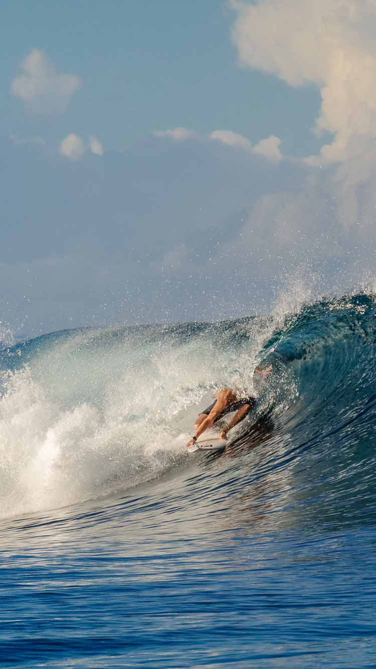 Nihi Sumba, Sumba Island-  surfer in a water barrel