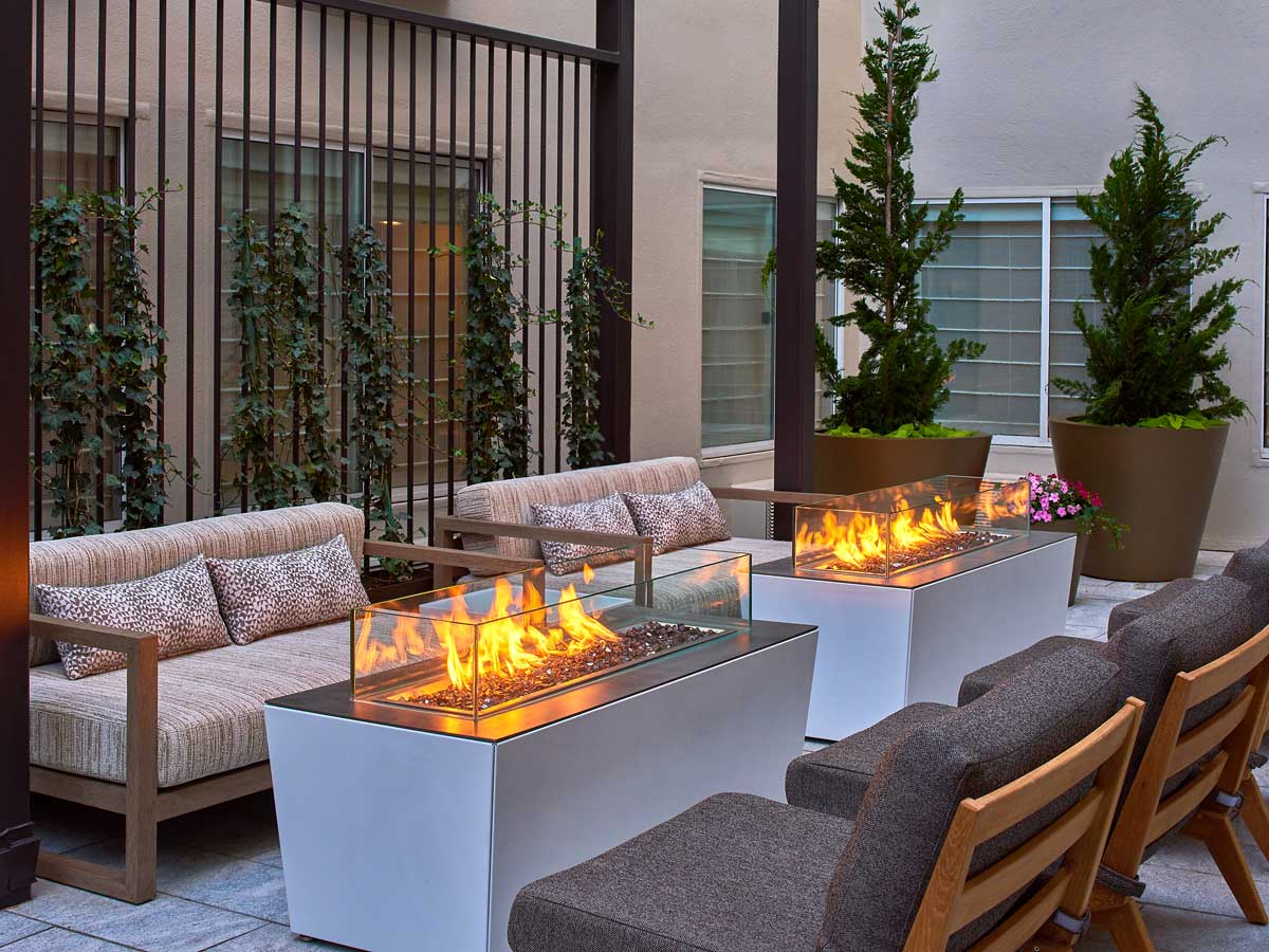 Hotel Zoe Fisherman's Wharf, San Francisco - outdoor terrace with couches and fire pits