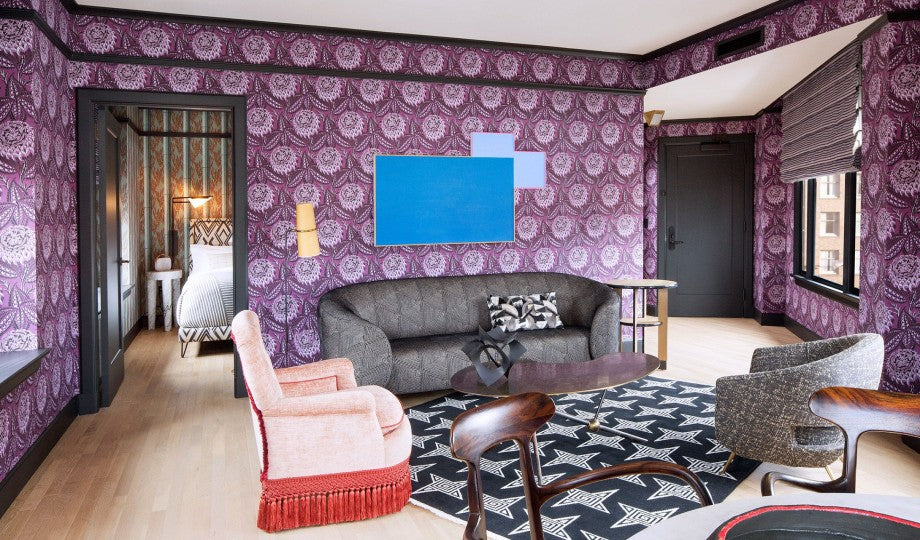 San Francisco Proper Hotel, San Francisco - hotel room with purple print wall paper, armchairs, and grey couch