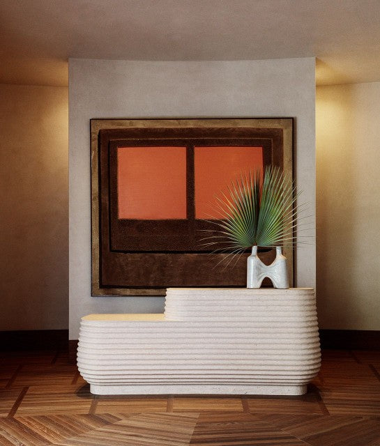 Santa Monica Proper, Los Angeles - hotel reception with textured stone desk, small potted palm, and orange window wall