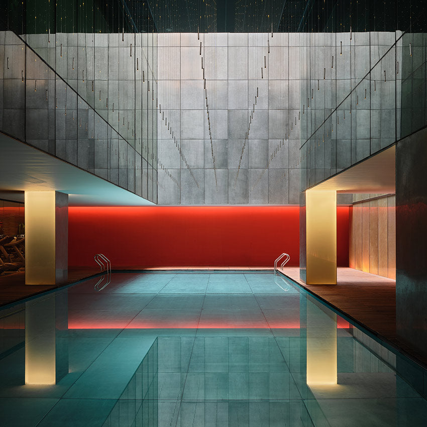 The Opposite House, Beijing - stainless steel designer pool with gold columns and hanging mobiles