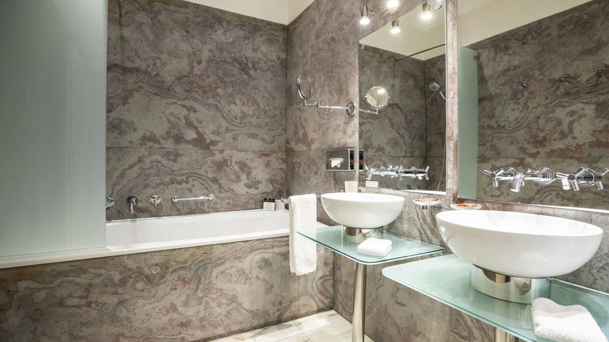 Smetana Hotel, Prague - sleek hotel bathroom with two sinks, bath tub, and marble walls