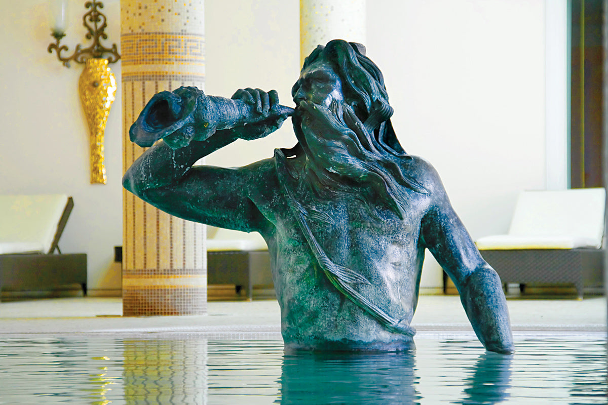 Terme Manzi Hotel & Spa, Ischia - close up of a green bronze statue of a man blowing on a shell in a pool