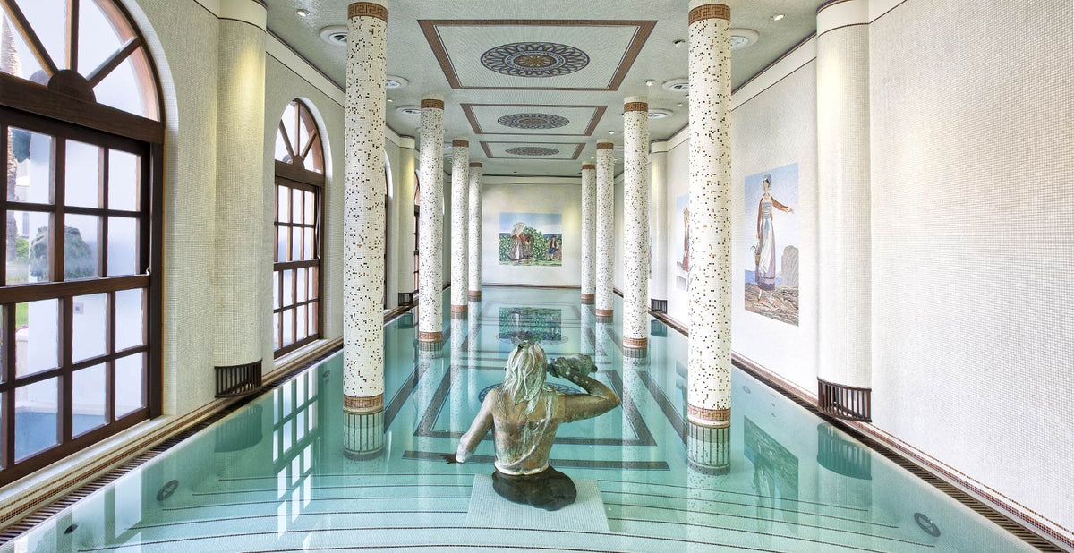 Terme Manzi Hotel & Spa, Ischia - hotel spa in Roman bathhouse style with stone columns and tile mosaics and a bronze statue of a woman in the pool