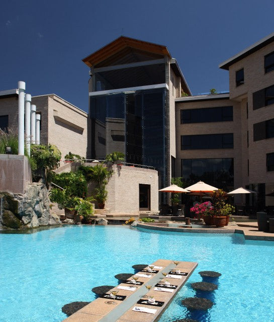 Tribe, Nairobi - hotel pool with table and chairs in the pool, set for meal