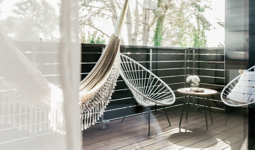 Twelve Senses Retreat, Encinitas - hotel room balcony with wicker chairs and hammock