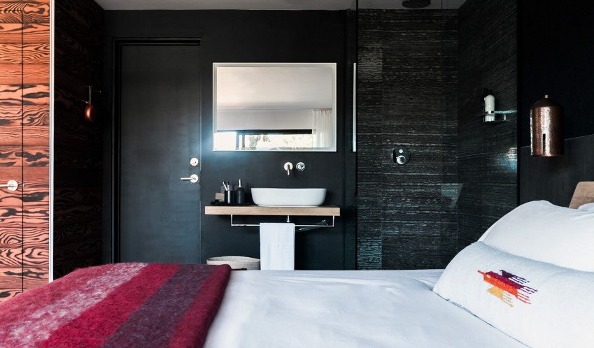 Twelve Senses Retreat, Encinitas - hotel room with sink, walk in shower, bed, and dark wood walls