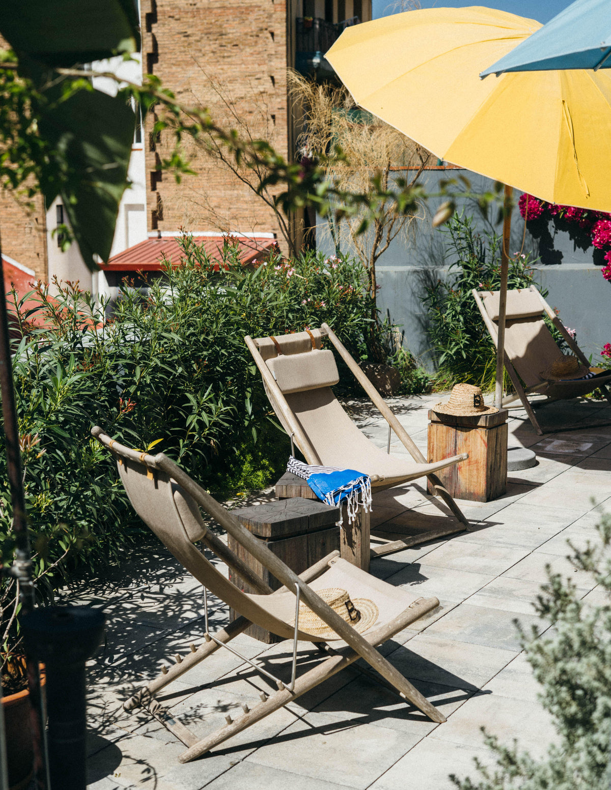 Hotel Brummell, Barcelona - rooftop deck with colorful sun umbrellas and lounge chairs