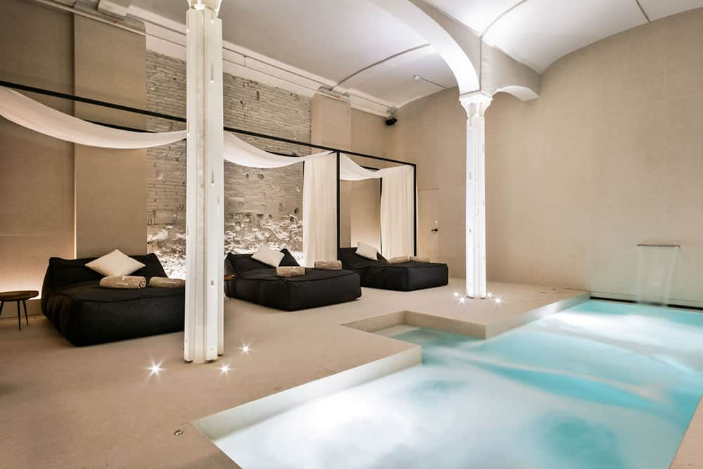 Yurbban Passage Hotel, Barcelona - contemporary style Roman baths spa with large canopied lounge beds