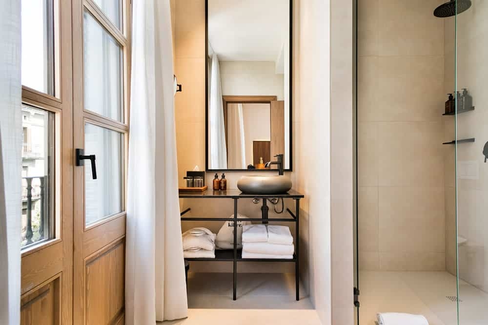 Yurbban Passage Hotel, Barcelona - airy modern bathroom with balcony windows and walk in shower