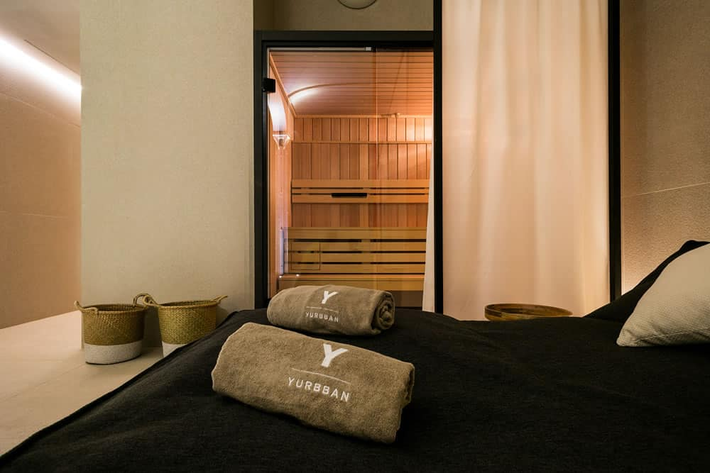 Yurbban Passage Hotel, Barcelona - hotel sauna with close up of lounge beds and Yurbban pool towels