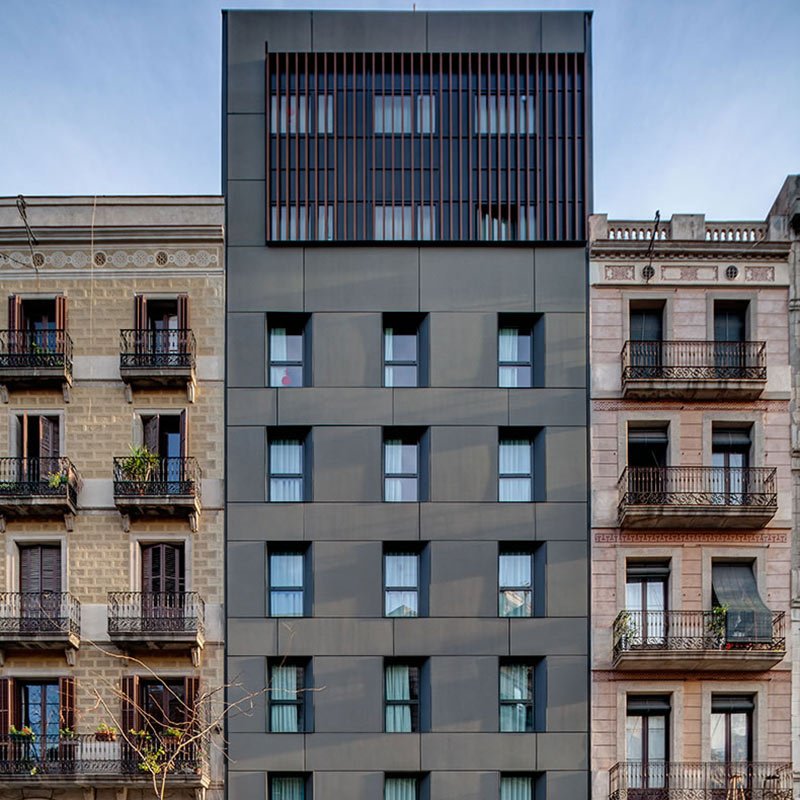 Yurbban Trafalgar, Barcelona - modern city building exterior next to 2 European-style buildings