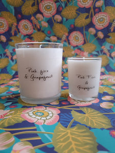 Pink fizz and grapefruit white candle in glass votive