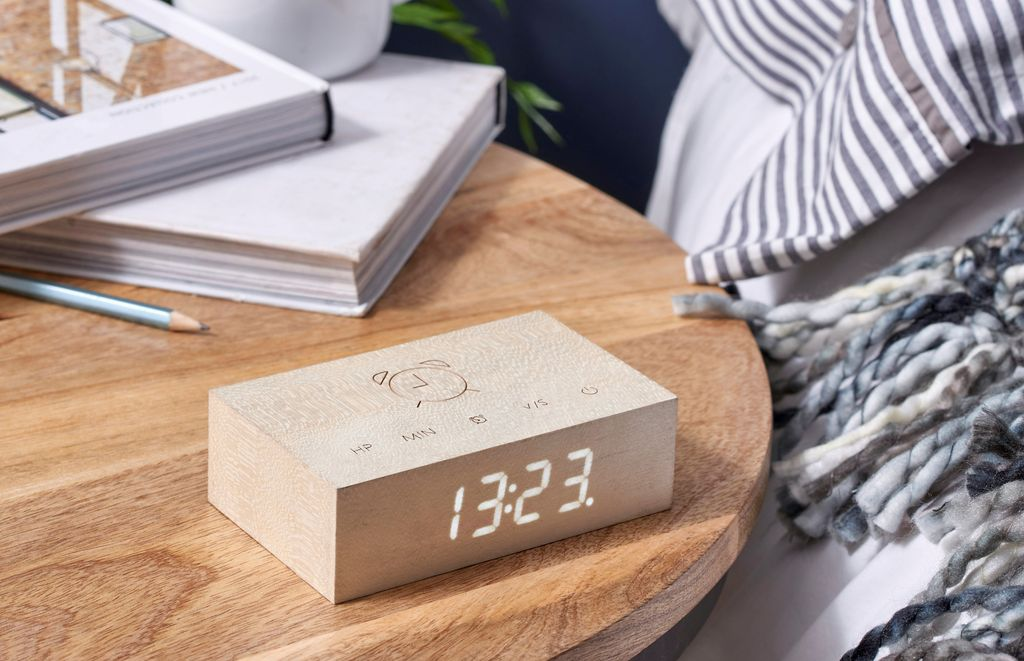 A clever natural wood alarm clock in White Maple which you turn over to activate alarm facility