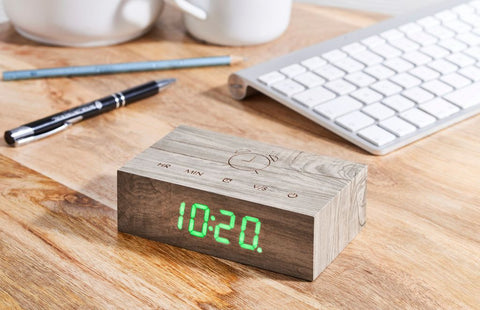 A clever natural wood alarm clock in Ash, which you turn over to activate alarm facility