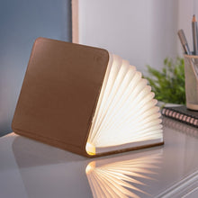Load image into Gallery viewer, A clever concertina paged light which looks like a book.  In faux brown leather.  When closed, 17W x 21.5H x 2.5cm
