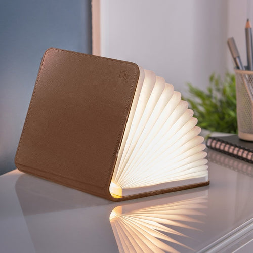 A clever concertina paged light which looks like a book.  In faux brown leather.  When closed, 17W x 21.5H x 2.5cm