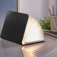 A clever concertina paged light which looks like a book. In faux black leather.  When closed, 9W x 12.2H x 2.5cm