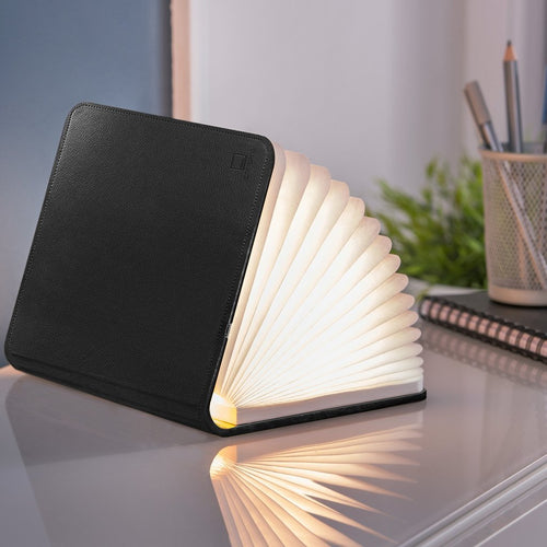 A clever concertina paged light which looks like a book. In faux black leather. When closed, 17W x 21.5H x 2.5cm