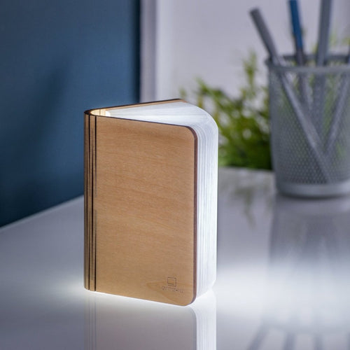 A clever concertina paged light which looks like a book. In maple wood casing. When closed, 9W x 12.2H x 2.5cm