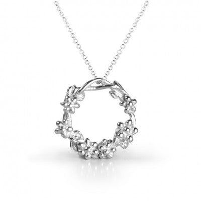 Silver necklace with twisted circles and small silver baubles