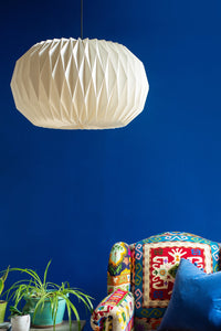 A large sphere shaped paper pleated light shade. H43 x W77cm