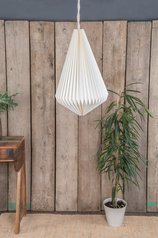 A white tear shaped pleated paper light shade.  Fairtrade