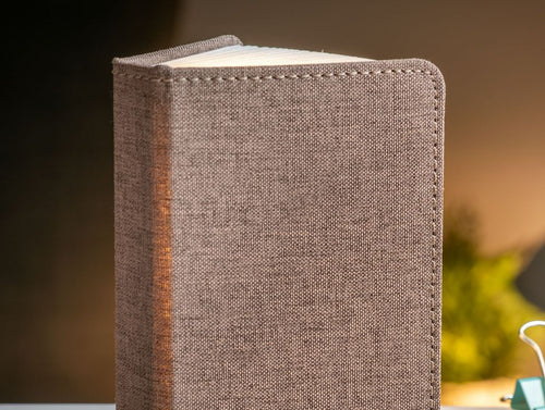 A clever concertina paged light which looks like a book. In linen coffee brown colour. When closed, 9W x 12.2H x 2.5cm
