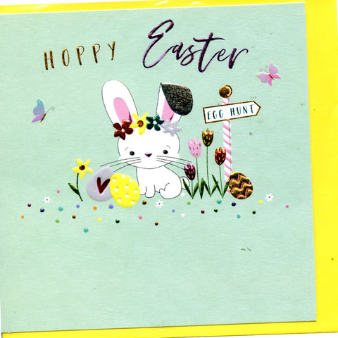 Hoppy Easter words on card with bunny with hat