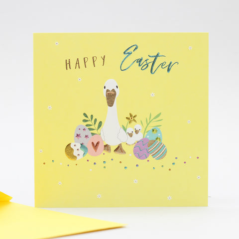 duck with eggs and happy easter words